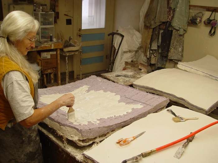 Gladys making a casting pattern from a silicone mold of the clay