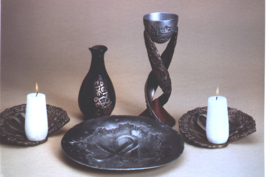 A Communion set made of pewter, bronze, glass and red heart wood for the Presbyterian Church