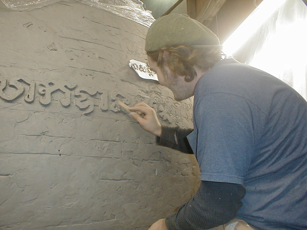 "Matt O""Baugh, my best modeler works on the clay lettering. Matt's an award winning Tatooist now."